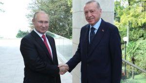 Cumhurbaşkanı Erdoğan, kendisini kapıda karşılayan Putin'in ısrarına kayıtsız kalmadı